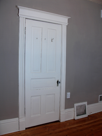 this room one door can be blocked to gain more wall living space one